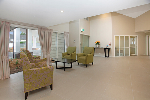 Lounge Aged Care Accent Chair in green fabric at reception