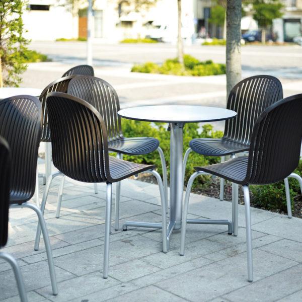 Hospitality Dining Skudo Folding Table Base, in outdoor setting